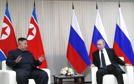 Russian President Vladimir Putin, right, and North Korea's leader Kim Jong Un talk during their meeting in Vladivostok, Russia, Thursday, April 25, 2019. North Korean leader Kim managed to match Russian President Vladimir Putin's manspreading - the two sat with knees spread wide apart as they chatted before the start of their first summit, which began Thursday in the far eastern port city of Vladivostok.(Sergei Ilnitsky/Pool Photo via AP)