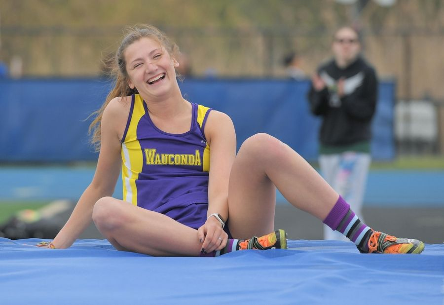 Wauconda High School's Grace Daun laughs after clearing the bar at 5 feet, 9 inches on her way to winning the high jump at the Lake County girls track meet in Lake Zurich Thursday. Daun's winning jump was 5-10.
