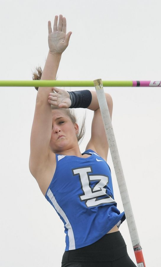 Lake Zurich's Kelsey Rothas wins the pole vault at 11 feet, 10 inches at the Lake County girls track meet in Lake Zurich Thursday.