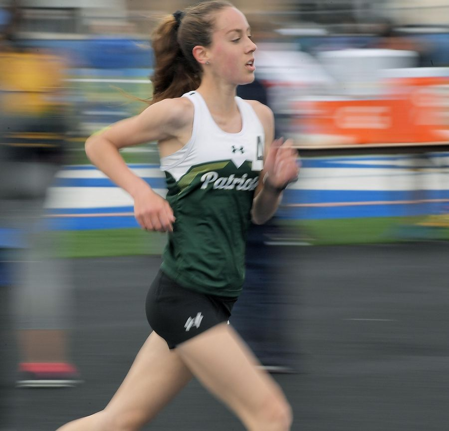 Stevenson's Natalie Sorenson competes in the 3,200-meter run at the Lake County girls track meet in Lake Zurich Thursday.