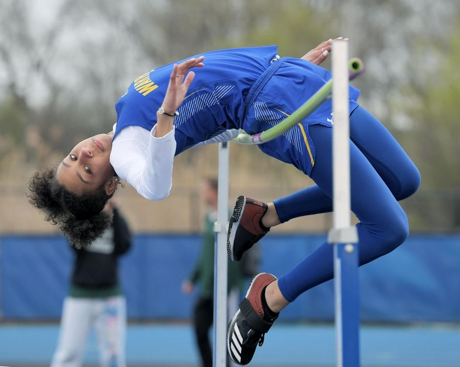 Warren's Annika Bynum tries to clear the bar in the high jump at the Lake County girls track meet in Lake Zurich Thursday.