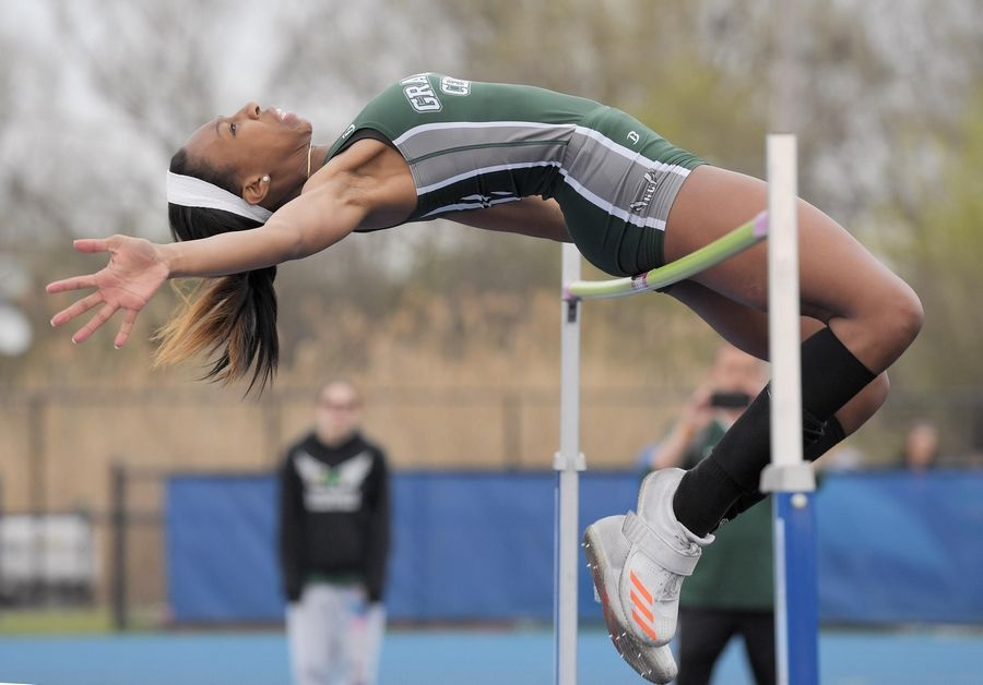 Grayslake Central's Meghan Fletcher gets over the bar in the high jump at the Lake County girls track meet in Lake Zurich Thursday.