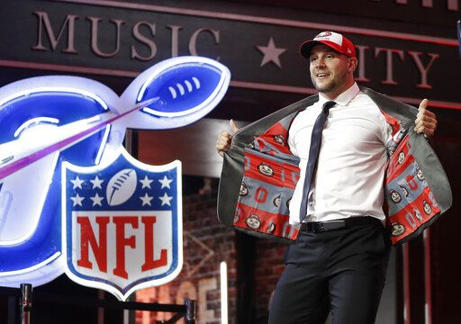 Ohio State defensive end Nick Bosa walks the stage after the San Francisco 49ers selected Bosa in the first round at the NFL football draft, Thursday, April 25, 2019, in Nashville, Tenn.