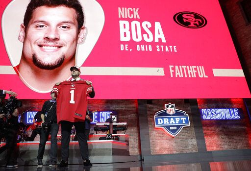 Ohio State defensive end Nick Bosa shows off his new jersey after the San Francisco 49ers selected Bosa in the first round at the NFL football draft, Thursday, April 25, 2019, in Nashville, Tenn.