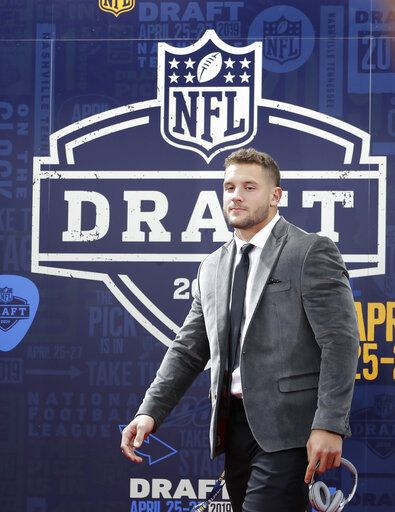 Ohio State defensive end Nick Bosa walks the red carpet ahead of the first round at the NFL football draft, Thursday, April 25, 2019, in Nashville, Tenn.