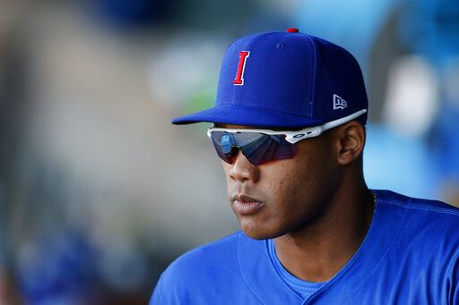 6bdcbd2bc2d Iowa Cubs shortstop Addison Russell walks out of the dugout before a  Triple-A baseball