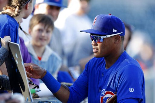 abd876f50c8 Iowa Cubs shortstop Addison Russell signs autographs before a Triple-A  baseball game against the
