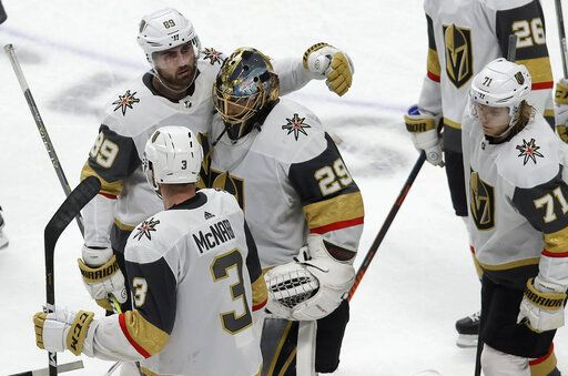 54858bcfc5a Vegas Golden Knights goaltender Marc-Andre Fleury (29) reacts with right  wing Alex