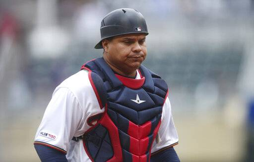 "FILE - In this April 18, 2019, file photo, Minnesota Twins' Willians Astudillo is shown during a baseball game against the Toronto Blue Jays, in Minneapolis.  The most popular player on the first-place Minnesota Twins is the third-string catcher and versatile everyman Willians Astudillo, whose all-out style has endeared him to the team and the fans since his debut last season. His cult hero status reaches a new high on Friday night, April 26, when the Twins give away ""La Tortuga� T-shirts in honor of his nickname, which means turtle in Spanish, at their game against Baltimore."