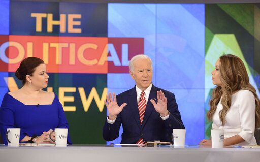 "This image released by ABC shows Democratic presidential candidate Joe Biden, center, with co-hosts, Ana Navarro, left, and Sunny Hostin during an appearance on ""The View,"" Friday, April 26, 2019. (Lorenzo Bevilaqua/ABC via AP)"