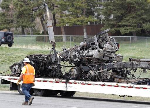 Police look at brakes after truck rams into cars, killing 4