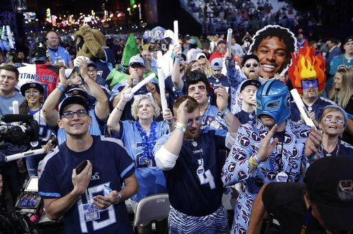 Fans watch the action on the main stage during the first round at the NFL football draft, Thursday, April 25, 2019, in Nashville, Tenn.