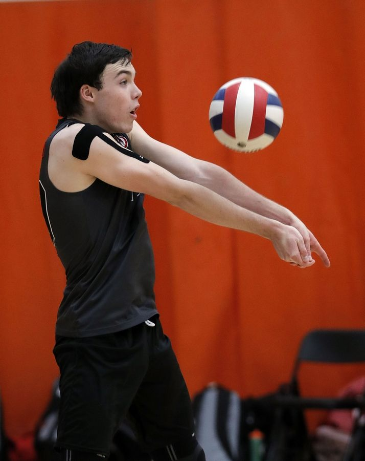 Palatine's Curtis McLennan volleys during their game Saturday at Libertyville High School.