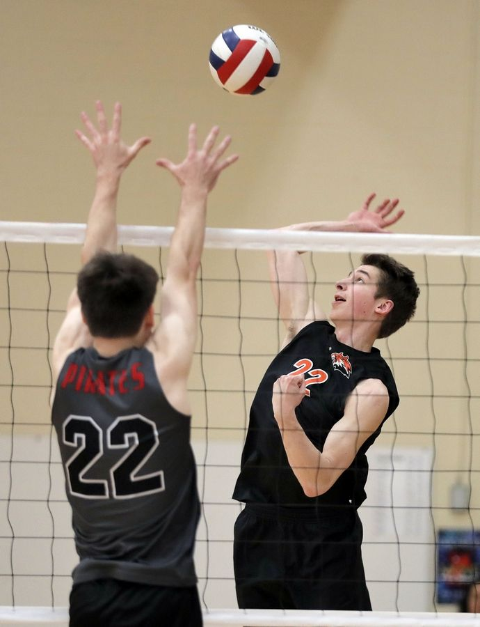 Libertyville's Alex Weick, right, spikes one at Palatine's Ben Rinella during their game Saturday at Libertyville High School.
