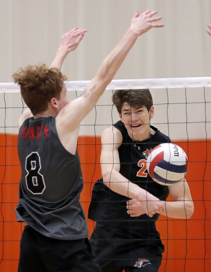 Libertyville's Patrick Graham has his spike blocked by Palatine's Aaron Spaletto during their game Saturday at Libertyville High School.