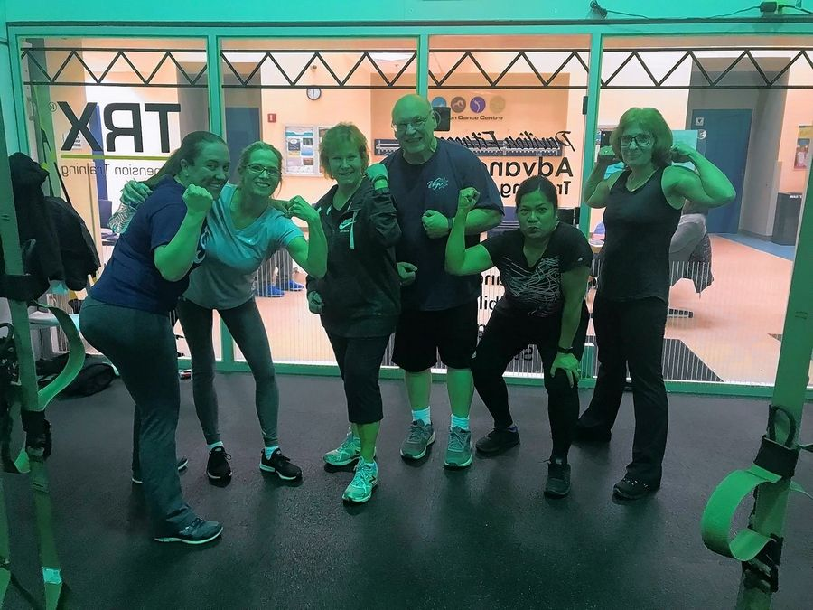 "Team ""Out My Weigh"" showing off after a TRX workout at Elk Grove Park District. From left to right, Victoria Quinn, Michelle Lopez, Jean Saritas, Brian Anders, Marissa Anders, and Debbie Cox."