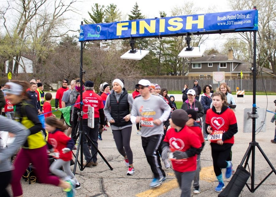 Runners and walkers start the race at the North Suburban YMCA's Healthy Kids Day 5K Run/Walk on Saturday, April 27th.North Suburban YMCA