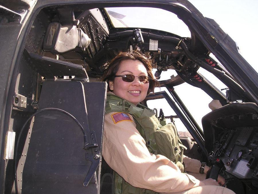 Duckworth, while serving with the Illinois Army National Guard, sits in a helicopter during her tour of duty in Iraq. In November 2004, Duckworth lost both legs when the helicopter she was in was struck by a rocket-propelled grenade on a mission near Baghdad.