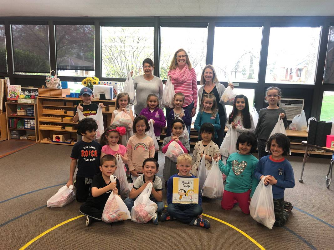 Blessings in a Backpack coordinators (from top left) Lauren Stephani, Barb Binverse and Ann Heineman pose with Northwest Suburban Montessori Kindergartners during the annual NSMS Kindergarten service project.Karly Giannelli