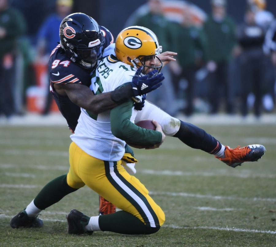 a1535dcdbba Bears outside linebacker Leonard Floyd takes down Green Bay Packers  quarterback Aaron Rodgers during last December's
