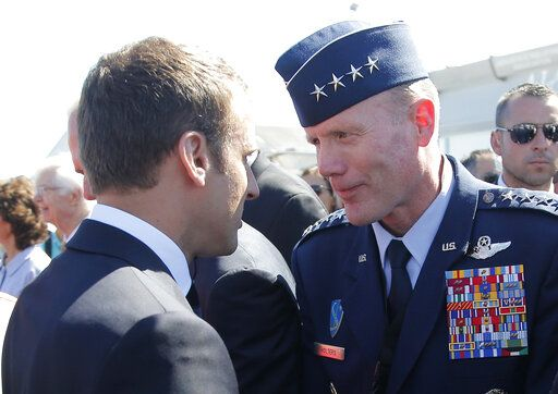 FILE - In this June 19, 2017 file photo, French President Emmanuel Macron, meets with Gen. Tod Wolters, while visiting the Paris Air Show in Le Bourget, north of Paris. At ceremonies Thursday in Germany and Friday in Belgium, Air Force Gen. Tod Wolters will take over for Army Gen. Curtis Scaparrotti as head of U.S. European Command and as NATO's Supreme Allied Commander Europe. Scaparrotti is retiring.