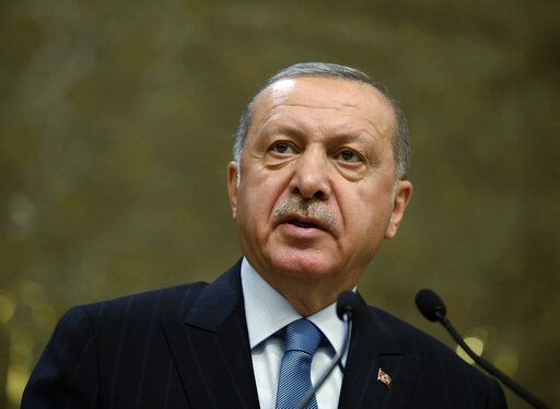 "Turkey's President Recep Tayyip Erdogan speaks during a meeting in Ankara, Turkey, Tuesday, April 30, 2019. Erdogan said a U.S. F-35 fighter aircraft program that excludes Turkey would be "" doomed to a total collapse."" Erdogan made the comments at the fair amid warnings from Washington that Turkey's decision to purchase the Russian S-400 missile systems will jeopardize Turkey's participation in the F-35 program.(Presidential Press Service via AP, Pool)"