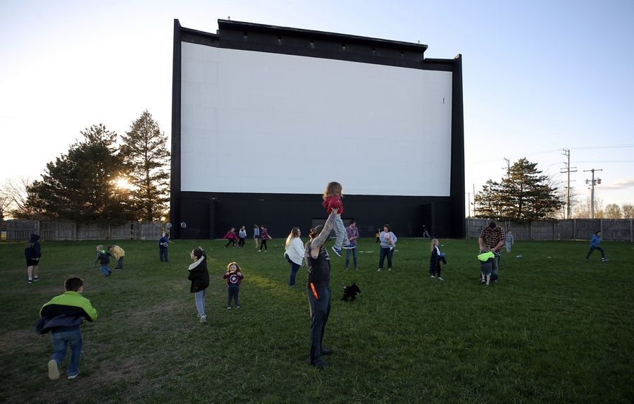 Kids play in front of the screen during opening night at the McHenry Outdoor Theater last Friday.