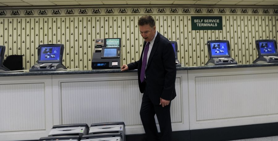 Howard Sudberry, senior director of marketing and communications at Arlington Park, checks out the self-service terminals inside the facility on Wednesday.