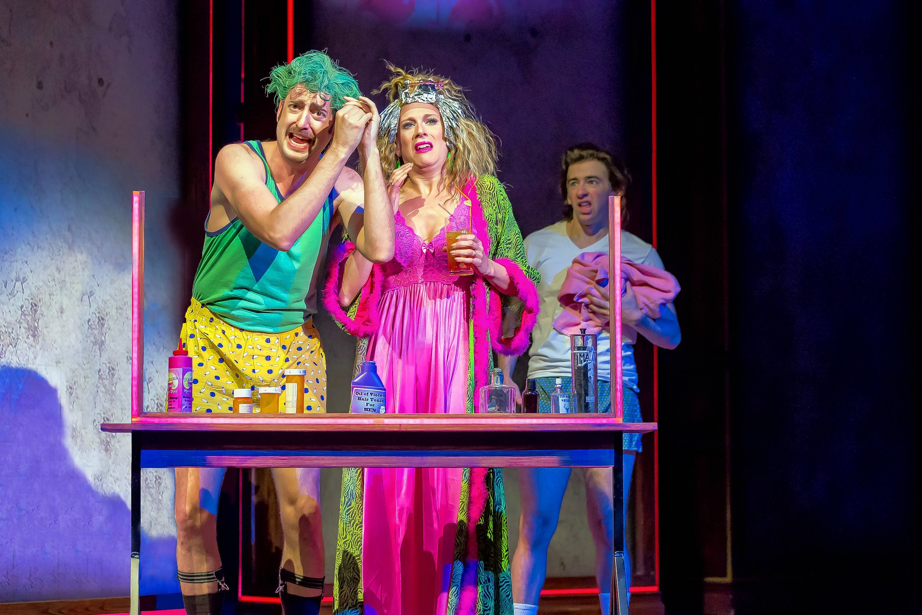 """Crass and corrupt, Matilda's parents (Jackson Evans, left and Stephanie Gibson) and brother (Evan C. Dolan) prefer looks and television over books and education in """"Matilda the Musical,"""" running through June 23 at Drury Lane Theatre."""