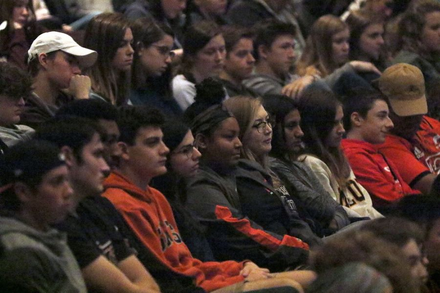 St. Charles East High School students listen to Becky Savage tell her story.