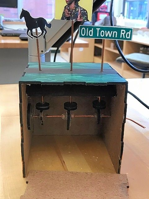 Students in Glenbrook North's Introduction to Engineering Design create automata boxes that use simple mechanisms to move visually appealing objects throughout the machine.