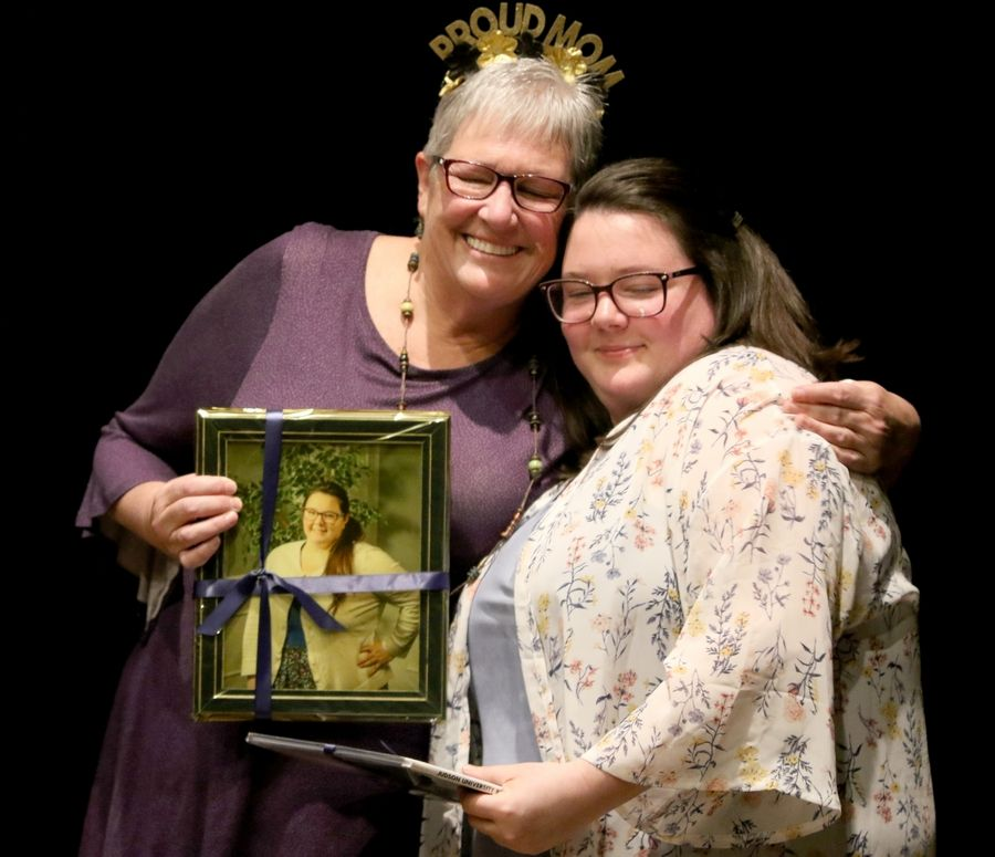 Emily Rogers of Elgin and her mom, Sharon, share a moment Friday at a Judson University event to recognize students who have completed the Road to Independent Living, Spiritual Formation and Employment program at the Elgin school.
