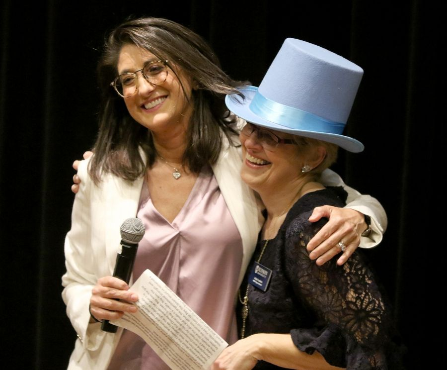 "Gayle Gianopulos, left, gave Kathy Lambert a Jimminy Cricket hat on Friday as a symbol of Lambert's having served as the ""conscience"" of the RISE program at Judson University in Elgin."