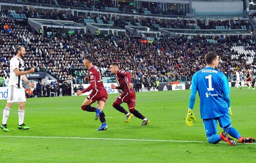 Torino's Sasa Lukic, center left, celebrates after scoring the first goal of the game during the Italian Serie A soccer match between Juventus FC and Torino FC at the Allianz Stadium in Turin, Italy, Friday, May 3, 2019. (Alessandro Di Marco/ansa via AP)