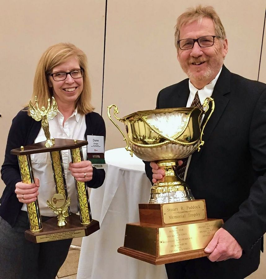 Daily Herald Editor John Lampinen, right, and Senior Deputy Managing Editor Diane Dungey hold the Stuart R. Paddock Memorial cup and trophy awarded to the Daily Herald Friday in the annual Illinois Press Association competition.