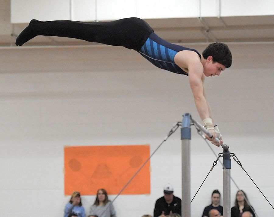 Lake Zurich's Peter Ferrigan performs on the high bar at the Hersey boys gymnastics sectional meet in Arlington Heights Saturday.