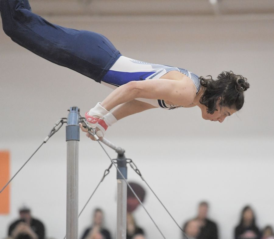 Prospect's Aaron Busiel performs on the high bar at the Hersey boys gymnastics sectional meet in Arlington Heights Saturday.