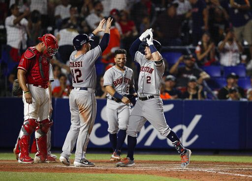 Houston Astros' Alex Bregman, right, is congratulated by teammate Max Stassi, as he runs home after hitting a home run in the eighth inning of a baseball game against the Los Angeles Angels, in Monterrey, Mexico, Saturday, May 4, 2019.