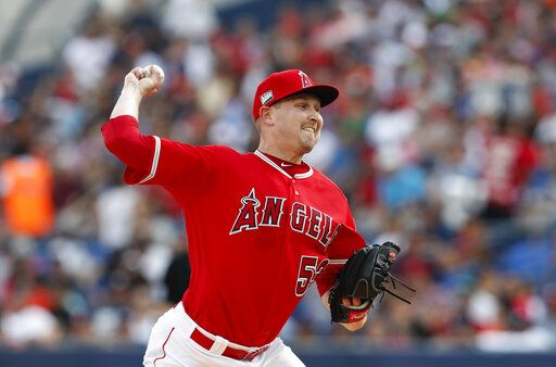 Los Angeles Angels' Trevor Cahill pitches during the first inning of a baseball game against the Houston Astros, in Monterrey, Mexico, Saturday, May 4, 2019.
