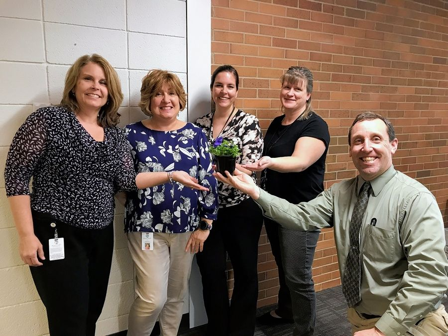 "Ruth Roenna of team ""Hanover Net Loss"" of village of Hanover Park's Financial Department received a gift for reaching her goals. From left to right, Sheryl Donovan, Ruth Roenna, Suzanne Thorson, Andrea Granias, and George Sullivan."