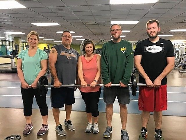 "Schaumburg Park District's ""Schaumburg Shredders"" are shown supporting each other. From left to right, Sandy Harris, Tony DeLeon, Sue Longo, Steve Richter, and Blake Hanauer."