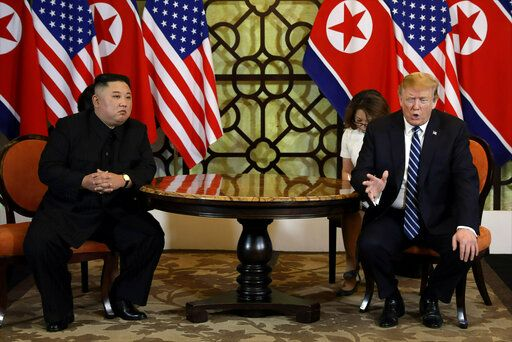 FILE - In this Feb. 28, 2019, file photo, U.S. President Donald Trump, right, meets North Korean leader Kim Jong Un in Hanoi, Vietnam.  The South Korean Joint Chiefs of Staff says North Korea has fired an unidentified short-range missile from its eastern coast. The firing Saturday, May 4, comes amid a diplomatic breakdown that has followed the failed summit earlier this year between President Donald Trump and North Korean leader Kim Jong Un over the North's pursuit of a nuclear arsenal that can target the U.S. mainland.