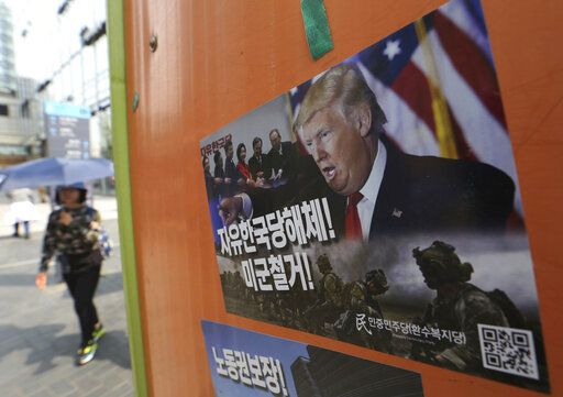 "A poster showing a portrait of U.S. President Donald Trump is displayed to demand withdrawal of U.S. troops from Korea peninsular on the street in Seoul, South Korea, Saturday, May 4, 2019. North Korea on Saturday fired several unidentified short-range projectiles into the sea off its eastern coast, the South Korean Joint Chiefs of Staff said, a likely sign of Pyongyang's growing frustration at stalled diplomatic talks with Washington meant to provide coveted sanctions relief in return for nuclear disarmament. The signs read: ""Withdrawal of U.S. troops."""