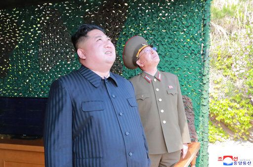 "This Saturday, May 4, 2019, photo provided on Sunday, May 5, 2019, by the North Korean government shows North Korean leader Kim Jong Un observing tests of different weapons systems, in North Korea. North Korean state media on Sunday said leader Kim observed live-fire drills of long-range multiple rocket launchers and unspecified tactical guided weapons, a day after South Korea's military detected the North launching several unidentified short-range projectiles into the sea off its eastern coast. Independent journalists were not given access to cover the event depicted in this image distributed by the North Korean government. The content of this image is as provided and cannot be independently verified. Korean language watermark on image as provided by source reads: ""KCNA"" which is the abbreviation for Korean Central News Agency. (Korean Central News Agency/Korea News Service via AP)"