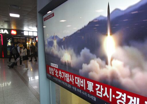 "A TV screen shows a file footage of North Korea's missile launch during a news program at the Seoul Railway Station in Seoul, South Korea, Saturday, May 4, 2019.  North Korea on Saturday fired several unidentified short-range projectiles into the sea off its eastern coast, the South Korean Joint Chiefs of Staff said, a likely sign of Pyongyang's growing frustration at stalled diplomatic talks with Washington meant to provide coveted sanctions relief in return for nuclear disarmament. The signs read: ""Strengthening military alertness."""