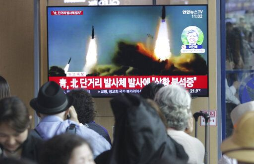 "People watch a TV showing a file footage of North Korea's missile launch during a news program at the Seoul Railway Station in Seoul, South Korea, Saturday, May 4, 2019. North Korea on Saturday fired several unidentified short-range projectiles into the sea off its eastern coast, the South Korean Joint Chiefs of Staff said, a likely sign of Pyongyang's growing frustration at stalled diplomatic talks with Washington meant to provide coveted sanctions relief in return for nuclear disarmament. The signs read: "" North Korea fired short-range missiles."""