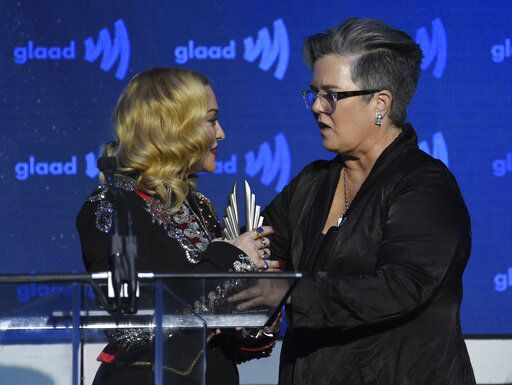 Honoree Madonna, left, accepts the advocate for change award from Rosie O'Donnell at the 30th annual GLAAD Media Awards at the New York Hilton Midtown on Saturday, May 4, 2019, in New York. (Photo by Evan Agostini/Invision/AP)