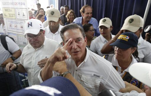 FILE - In this May 2, 2019 file photo, presidential candidate Romulo Roux of the Democratic Change party, blows a kiss during his closing campaign rally in Panama City. Roux, a 54-year-old businessman has the endorsement of supermarket magnate and former president Ricardo Martinelli, who is currently in jail awaiting trial on charges of political espionage.