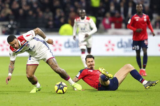 f5ca9f9d81e Lille moves closer to Champions League after draw with Lyon