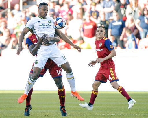 Real Salt Lake defender Nedum Onuoha (14) holds onto Portland Timbers forward Jeremy Ebobisse (17) during an MLS soccer match Saturday, May 4, 2019, at Rio Tinto Stadium in Sandy, Utah. (Leah Hogsten/The Salt Lake Tribune via AP)
